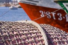Fishing net. Partial view of a fishing net and a fishing ship Stock Image