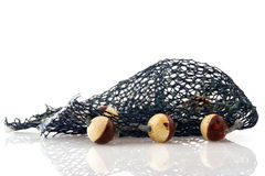 Fishing net. Blue fishing net with corks isolated over white background Stock Photo