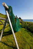 Fishing net. An ancestral fishing net is drying on a rack Royalty Free Stock Photos
