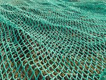 Fishing Net. A green fishing net spread on ground Stock Photography