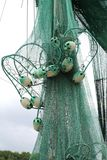 Fishing net. Large fishing net hanging from boat with buoys stock photography