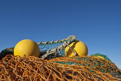 Fishing net. Typical fishing net with yellow buoys royalty free stock image