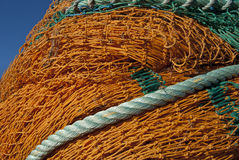 Fishing net. Typical orange fishing net stock photos