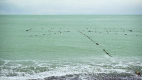 A fishing net in the sea near the shore stock footage