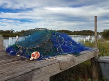 Fishing net background. Fishing net and crab traps on an old wharf royalty free stock image