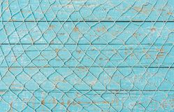 Mediterranean maritime background with fishing net over turquoise rustic wood. Fishing net background texture over rustic maritime turquoise blue wood with copy royalty free stock image