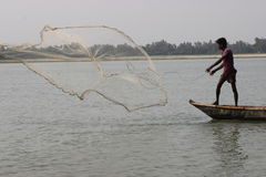 Fishing net in Bangladesh. Fisherman The fisheries sector plays an important role in food consumption, nutrition, employment and export. The sector contributes Stock Photo