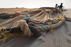 Fishing net on the beach. Outdoor shoot with fishing net on the evening beach Stock Photography