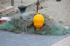 Fishing net on the beach. A fishing net on the beach Stock Photo