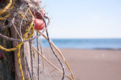 Fishing net on the beach. Fishing net-detail.Blue sky and sea in the background Stock Photography