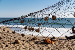 Fishing net in beach Royalty Free Stock Images