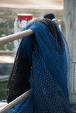 Fishing Net. Blue Fishing Net over railing stock images