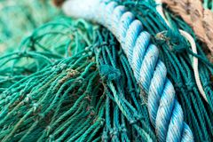 Fishing net and blue rope. Background with selective focus stock photography
