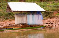Fishing net on Boat house Fishing. Mekong River background on the river of Thailand royalty free stock photo