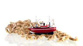 Fishing net with boat Stock Images