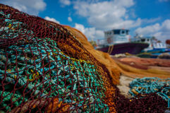 Fishing net, Boats and clouds. Colorful fishing net Stock Images