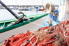 Fishing net and boats waiting for the small marina. Royalty Free Stock Photography