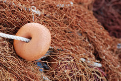Fishing net with brown floats Stock Photos