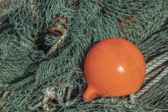 Fishing net with a buoy royalty free stock photos