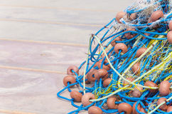 Fishing net close up. Fishing net detail on harbor bordwalk. Preparation for night fishing Stock Images