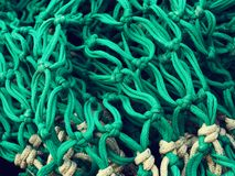 Fishing net close up. Close up of a fishing net in a fishing harbour stock images