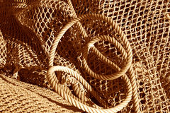 Fishing Net. Closeup background with fishing net and rope royalty free stock image