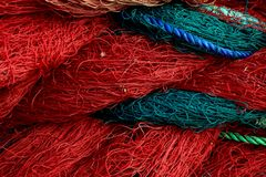 Fishing net closeup. Rope texture. Background with blue and red ropes stock photos