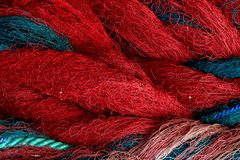 Fishing net closeup. Background with blue and red ropes. Fishing net closeup. Rope texture, Background with blue and red ropes stock photo