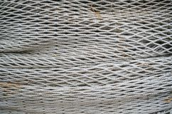 Fishing net closeup texture. Fishermen tool. Authentic rope. Thick blue ropes stock photos