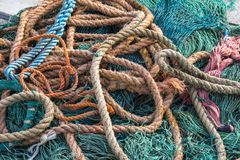 Fishing net. Closeup view at the fishing net on the boat royalty free stock images