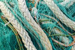 Fishing net. Closeup view at the fishing net on the boat stock photos