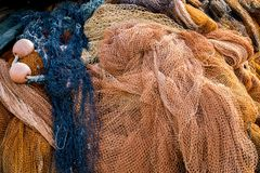 Fishing net. Closeup view at the fishing net on the boat royalty free stock photography