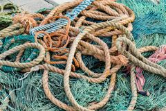 Fishing net. Closeup view at the fishing net on the boat stock photography
