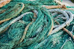 Fishing net. Closeup view at the fishing net on the boat royalty free stock image