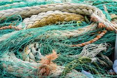 Fishing net. Closeup view at the fishing net on the boat stock image