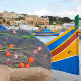 Fishing net. And colored boats as background royalty free stock images