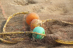 Fishing net and colorful floats stock image