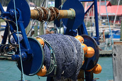 Fishing net. Detail of a fishing net rolled up on a trawler royalty free stock images