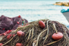 Fishing net. Detail of a fishing net in a small port Royalty Free Stock Image