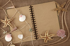 Fishing net and exercise book. On brown background Royalty Free Stock Image
