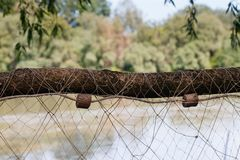 Fishing net, Fisherman`s tools, net drying on the branches stock photography