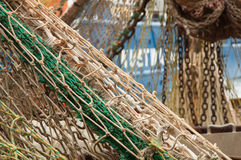 Fishing net on a fishing boat. Detailed picture of a fishing net of a fishing boat in Scheveningen the Netherlands stock photo