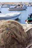 Fishing net and fishing boats Royalty Free Stock Photography