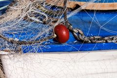 Fishing net. On the bow of the boat, part of the frame stock photography