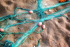 Fishing-net. Fishnet, a fabric with an open mesh resembling a fishing net stock photos