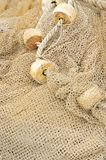 Fishing net with floats. Detail of fishing net with floats drying royalty free stock photos