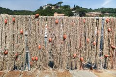 Fishing net with floats. Is hanging on the wall Stock Photo