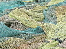 Fishing Net. A green fishing net spread on ground royalty free stock image