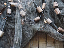 Fishing net is hanging on the wooden wall Royalty Free Stock Image