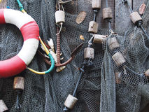 Fishing net is hanging on the wooden wall Royalty Free Stock Photo